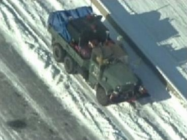 National Guardsmen delivering supplies