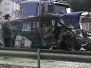 Van crushed by a truck