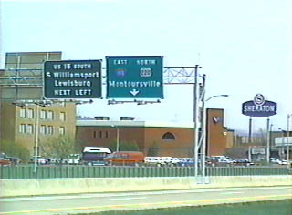 Overhead gantry on a street parallel to Interstate 180
