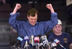 Governor Schweiker with his fists raised in victory