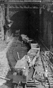 Railcars removing rock from the excavation of the Blue-Kittatinny Mountain