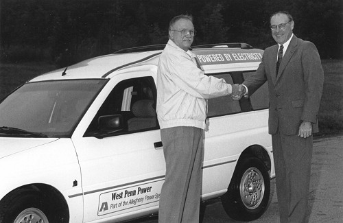 Representative Herman Mihalich and West Penn Power President Jay Pifer with the Ford Ecostar van in the background