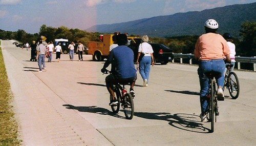 """""""Roll & Stroll"""" attendees walking and biking down the unopened expressway"""