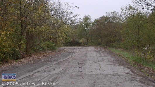 A section of PA 88 at the Low Hill Road intersection that was abandoned when the expressway was completed in 1977