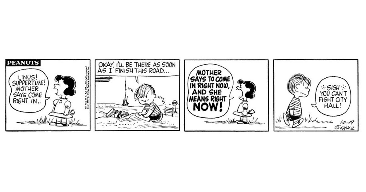 """Linus is playing in the dirt in a strip that could be called """"It's a Road, Charlie Brown."""""""