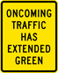 Oncoming Traffic Has Extended Green Sign (W25-1)