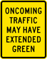 Oncoming Traffic May Have Extended Green Sign (W25-2)
